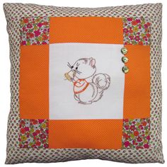 """A Little Nutty"" pillow with vintage embroidered quilt block of a squirrel in a sweater, vintage and new fabrics, and vintage buttons."