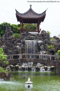 The waterfall at Fukushuen Garden 福州園 in downtown Naha 那覇市 Okinawa 沖縄本島, Japan 日本国.