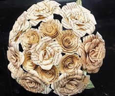 This bouquet is made from the pages of a recycled book. This was either a Harry Potter book or Les Miserables or Jane Austen or Paper Towns or