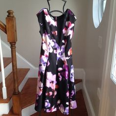 New! Watercolor dress Medium length floral watercolor dress soft with beautiful pink zipper detail. Would be great for office church or date night out. Pair with a blazer or a bright pair of pumps to finish the look. Maggy London Dresses Midi
