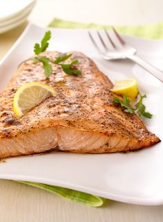 We brushed salmon fillets with butter, lemon zest and black pepper to turn fish into a tasty weeknight meal.