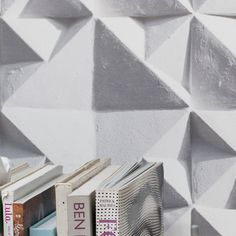 The award winning Geo is an illusionist geometric repeat that captures the fascinating play of shadows and light on the surface textures of architectural wall panels. The design is part of our Concrete Inspirations theme.