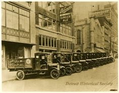 Vernor's Ginger Ale delivery trucks parked in front of the company bottling plant located on the west side of Woodward Ave just south of Woodbridge St.  Mariners Church, located at the n.w. corner of Woodward and Woodbridge, can be seen in the center right area of the photo.  c. 1925  (Detroit Hist. Soc.)