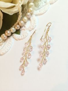This listing is for dangle bridal earrings. Pair of lovely wedding earrings produced in 14K gold filled. These earrings are created in our studio with goldfilled wire and light pink glass beads. The earring measures are about 2 inch length and 0.4 wide. Good as bridal jewelry or as
