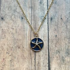 Navy and gold starfish necklace, starfish necklace, blue starfish necklace, starfish jewelry, nautical jewelry, vacation jewelry by MGreenhalghDesigns on Etsy https://www.etsy.com/listing/525676178/navy-and-gold-starfish-necklace-starfish