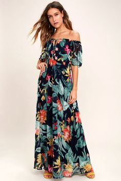 Lulus Exclusive! We can go on and on about how much we adore the Infinite Love Navy Blue Print Off-the-Shoulder Maxi Dress! Stunning black chiffon (with a navy blue, green, pink, orange, and yellow tropical print) falls from an elasticized, off-the-shoulder neckline, to a tying accent and elastic waist. Skirt stuns as it falls to a maxi length.