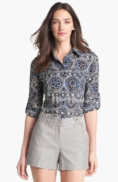 A wear-anywhere, cotton shirt with utilitarian accents like epaulets, roll-tab sleeves and box-pleated pockets features an unmistakably confident print. Color(s): tory navy. Brand: Tory Burch. Style Name: Tory Burch Brigitte Print Military Shirt. Style Number: 682942.