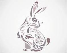 I like how the rabbit is in a way hollow and then they filled it in with shapes. I like how they used black and greys and the shapes were tear shapes.
