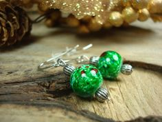 Looking for a stocking stuffer? These beautiful green dangle earrings will bring a smile to her face! #stockingstuffer #greenearrings