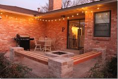 This patio that comes with built-in seating and a firepit was created in one week. #patio #firepit #patio_ideas  #the-phillip-family