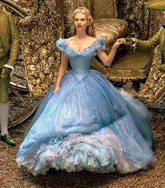 Cinderella's costume designer Sandy Powell dished to Us Weekly about bringing all of the movie's gorgeous costumes to life--and how star Lily James reacted to that blue dress; find out more here