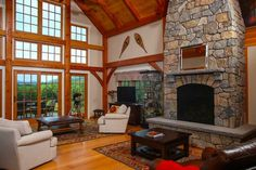 Craftsman Style Timber Frame Great Room by Davis Frame