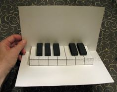 Easy piano pop up card with free template. I know a few people who would love to receive this clever card.