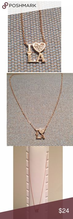 """I Love LA Rose Gold Tone Necklace w/ Clear Sparkle Represent your pride with this NWT I ❤️ LA rose gold tone necklace!  The heart is embedded w/ tiny clear rhinestone chips. The delicate chain is 17-1/2"""" overall length with 2 loops to size smaller at 16-3/4"""" & 15-3/4"""". Spring clasp closure. Charm is approx. 3/8"""" x 3/8""""-see pic. This brand new item will come in original package. Complies w/safety regulation of lead & other components. Pretty way to display props to your fav city! Jewelry…"""