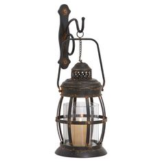 """HOME DECOR – ILLUMINATION – CANDLE LANTERN – Nautical-style hanging metal wall lantern with a glass hurricane.  Product: Lantern Construction Material: Metal and glass Color: Bronze; Dimensions: 19"""" H x 10"""" Diameter"""