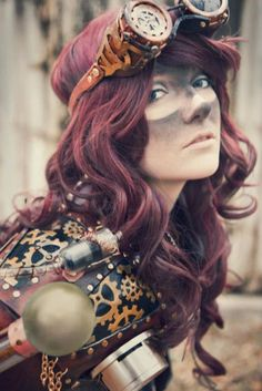 OH GOSH. Steampunk cool. And the soot on her face like she just blew something up. Sooo cute.