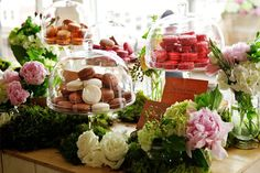 Glass-domed cake stands and bell jars aren't just for cakes and cupcakes anymore. Stack handfuls of petite treats atop mismatched domed pedestals for a lovely dessert display.    Photo via  The Style Co. .