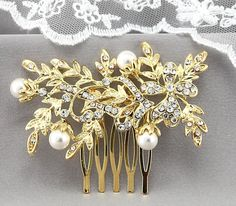"Bridal Comb Beautiful Gold Crystal Wedding by goddessdesignsgems, $48.00  ""Amazingly Beautiful"" bridal comb features a ""gold"" vintage style focal piece with a stunning flower & leaf design encrusted with sparkling clear Austrian Crystals and lustrous white pearls. The focal piece is gold plated and measures approx 2 3/4"" in length and 1 1/4' in width."