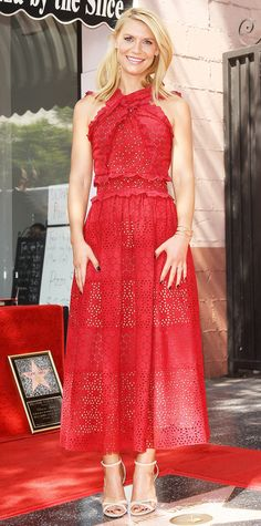 Claire Danes received a star on the Hollywood Walk of Fame in a siren-red broderie anglaise Oscar de la Renta number (fresh off the runway), complete with nude strappy Kurt Geiger London sandals.