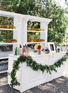 A wedding cocktail bar was a hot trend a couple of years ago and now it's almost classics, we see many bars at large weddings. There's a cocktail hour at many weddings, too, so a bar space is a must. Romantic Backyard, Wedding Backyard, Buffet, Garden Wedding Centerpieces, Wedding Reception Decorations, Reception Ideas, Wedding Ideas, Wedding Inspiration, Wedding Receptions