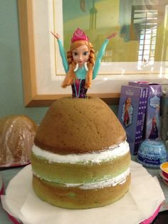 "Anna doll cake before decorating. (For Ava, July 2014 by Carmen)  Used Wilton Wonder mold on two 8"" rounds. Cake is blue raspberry."