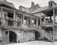 "New Orleans circa 1937. ""Courtyard, 620-621 Gov. Nicholls Street."" Potted plants and underpants. 8x10 negative by Frances Benjamin Johnston. Prints from $15."