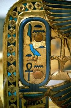 Tutankhamun's cartouche on his throne, Egyptian Museum, Cairo. Detail from a throne discovered in the tomb of tutankhamun whose name is here given as TutankhATEN - a relic from the time before the worship of Amun was restored and the king changed his name.