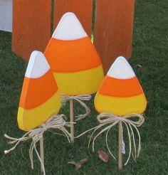 Candy corn yard picks, would look awesome in my long driveway(: Halloween Yard Art, Halloween Wood Crafts, Fall Crafts, Fall Halloween, Holiday Crafts, Holiday Decorations, Halloween Wreaths, Halloween Signs, Wooden Halloween Decorations