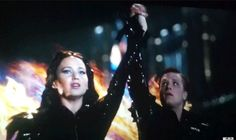 Love how Peeta is looking at their hands, like he can't believe it!