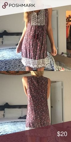 Adorable Hollister Embroidered Dress Size XS  NWOT Above the knee  Embroidery all on front bodice and four inches thick on bottom Hem  So cute !  Has two tie tassels Button snap closure in back   Bundle for a better deal :) Hollister Dresses Mini