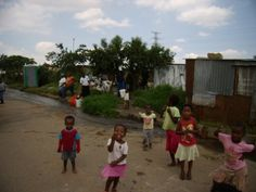 The smiles on the kids' faces in Soweto, outside Johannesberg, South Africa