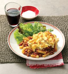 Pasticcio is a Greek pasta bake made with lamb mince, tomato sauce and layers of macaroni.