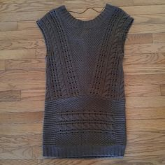 Free People Reversible Knit Sweater Tunic Top Brown knit sweater top by Free People pairs nicely with leggings or skinny jeans, and looks adorable with a long sleeve top underneath. Size XS. Material: 70% wool, 20% Nylon, 10% Alpaca. Can be worn with back of sweater as front as shown in last pic! Free People Sweaters