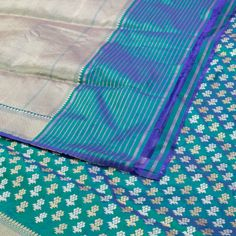 """This """"Rama #Green"""" #handwoven Banarasi Silk Sari from Shivangi Kasliwal is woven with gold and silver zari floral bhutas all over the body that is set off by a zari border and pallu. The border is repeated on the rama green blouse that completes the sari."""