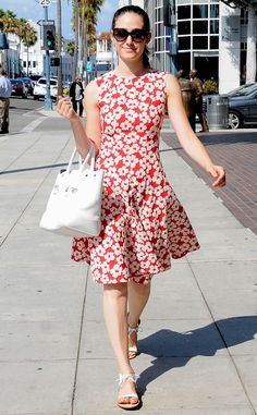 Perfect 10 from Celebrity Street Style  Like she ever misses a beat! Emmy Rossum is prim and polished in a sweet red floral frock with Loeffler Randall sandals.