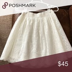 Bebe White Skirt Beautiful Bebe White Lace Looking Skirt with elastic in the waist band. Size XS/S. Never been worn. Bebe Skirts Circle & Skater
