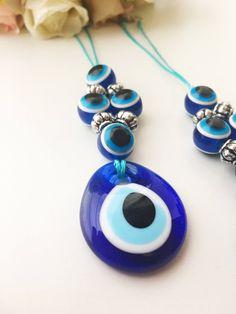 Evil eye beads, car rear view mirror charm, evil eye charm, blue evil eye, turkis evil eye beads, rearview mirror decor, car accessories by EvileyeFavorSupplies on Etsy https://www.etsy.com/listing/564991581/evil-eye-beads-car-rear-view-mirror #evileye #evileyes #carrearview #mirrorcharm #mirrorcharmdecor #blueevileye #evileyebeads #evileyecharm #cardecor