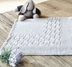 """I thoroughly enjoyed designing the """"Bellvue' blanket for a family who are awaiting the arrival of their baby boy. If knitted in a pure white this delicate blanket would also make the perfect christening shawl, which is sure to become an heirloom."""