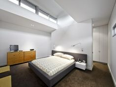 Too plain, but I like the wall behind the bed leading to walk-in wardrobe, then bathroom.