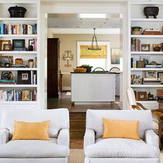 Clean Display  Get the most storage and style out of built-ins by filling the shelves with books; stack them vertically on the lower shelves and keep the top shelves more open. Arrange accessories two or three deep, keeping them fairly symmetrical for a clean look.