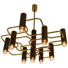Stunning Mid-Century Modern Chandelier by Gaetano Sciolari for Boulanger   From a unique collection of antique and modern chandeliers and pendants at https://www.1stdibs.com/furniture/lighting/chandeliers-pendant-lights/