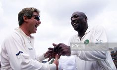 Robin Smith (L) and Viv Richards ex-captain of the West Indies cricket team enjoy a joke after the toss up for the Malcolm Marshall memorial cricket match at the Honorable Artillery Company cricket ground in London 27 July 2000. The match is being played in honor of Malcolm Marshall the West Indies fast bowler who died of cancer last year to raise money for his widow and son. ELECTRONIC IMAGE AFP PHOTO AFP/HUGO PHILPOTT/hp/bw