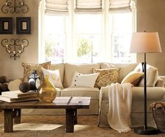 I love the tones in this livingroom - it's warm and inviting. Love the window treatment