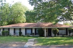 Exterior, : Fantastic Ranch House Curb Appeal With White Brick Pillars And Dark Brown Paneled Glass Door Brick Ranch Houses, White Brick Houses, House Exterior Color Schemes, Ranch Style Homes, Mediterranean Homes, Curb Appeal, House Design, Rambler House, Split Entry