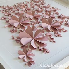 flowers made from hearts folded in half... this could make for a beautiful backdrop if they were attached to a sheet or screen!