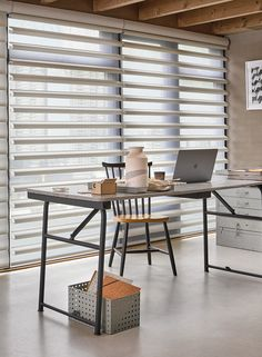 Pirouette® Shades - soft fabric vanes give a clear view to the outside whilst maintaining privacy inside. The unique design puts you in control of the amount of light that enters the room, with dramatic effect.