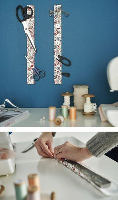 A close-up image of a woman gluing a floral textile to a magnetic knife wrap. A small wooden shelf with a magnetic knife rack attached to the underside holds jars filled with beads. Coin Couture, Sewing Room Storage, Sewing Rooms, Craft Storage, Small Wooden Shelf, Magnetic Knife Rack, Diy Rangement, Creation Couture, Sewing Studio