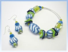 Assemble the bracelet using a #7 clear elastic cording. Add assorted glass beads as desired. Create the matching earrings using 2 of the spacer beads for each earring. Enjoy!