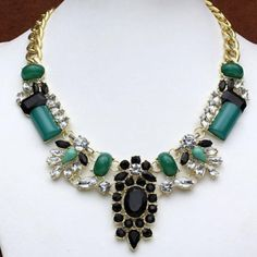 HPNWT gorgeous green statement necklace Brand new with tags..green and black stones with crystals make this perfect for any occasion! Goldtone chain with adjustable clasp.Host pick 1/31 Girly GirlNO TRADES Jewelry Necklaces