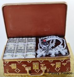 "Pastry Palace Las Vegas - ""Vuitton Case of Cash.""  Logo-embossed Louis Vuitton Briefcash filled with Cash & Bling. Specialty Cake #257."